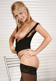Young teaser using black nylons for seduction